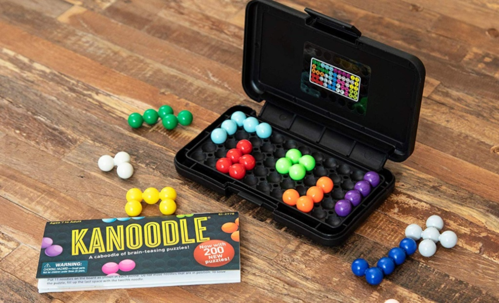 kanoodle game and pieces on wood floor