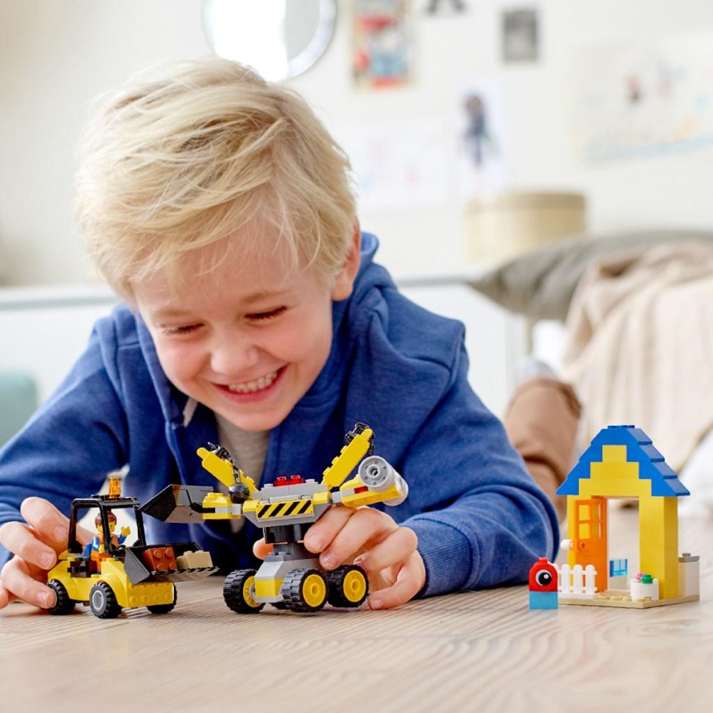 boy playing wuth lego Emmet's Builder Box