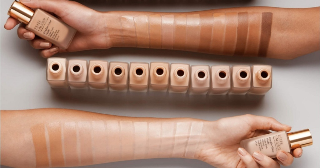 two arms with estee lauder foundation swatches