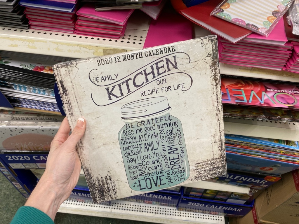 hand holding a Family Kitchen Recipe Calendar