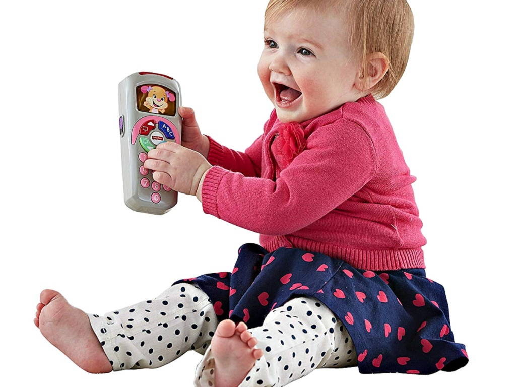 Fisher-Price Laugh & Learn Sis' Remote with baby