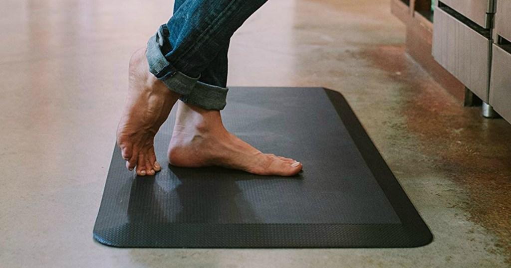 lady standing on a foam mat