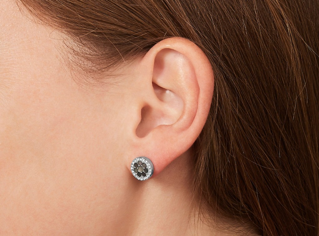 woman wearing Fossil Earrings
