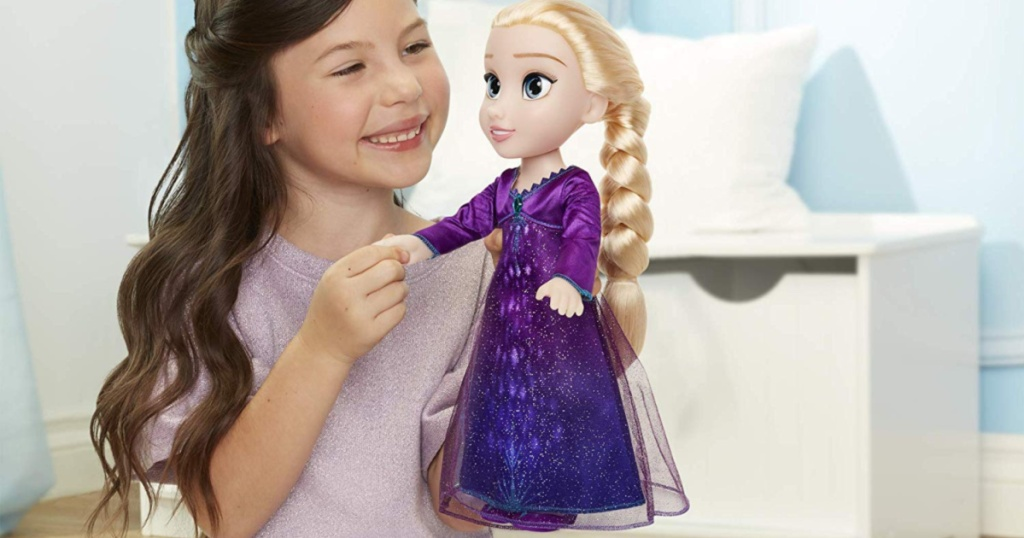 girl playing with frozen 2 elsa doll