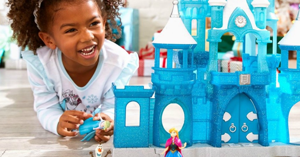 girl playing with Frozen Playset