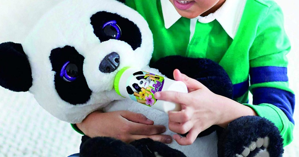 Boy playing with a FurReal Plum The Curious Panda Bear