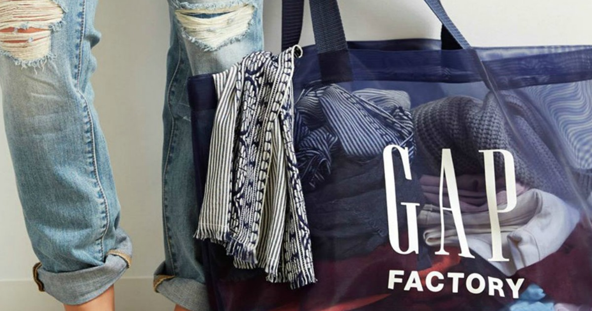person standing next to a GAP Factory Bag