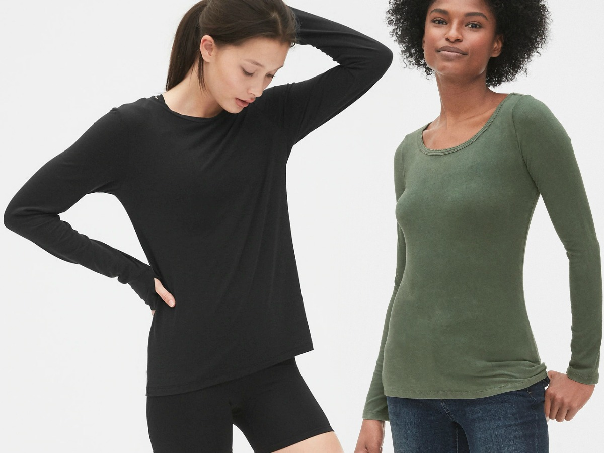 Women wearing two styles of Gap shirts