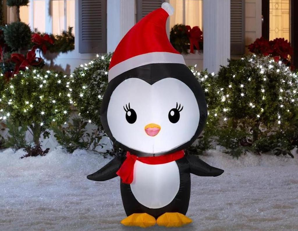Gemmy Lighted Penguin Christmas Inflatable in snowy yard