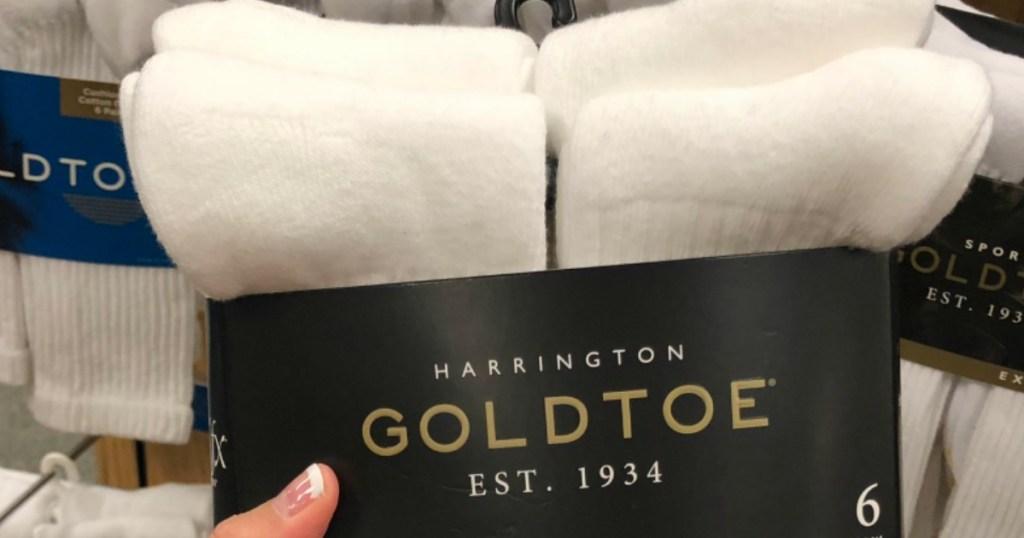 hand holding pack of Goldtoe Socks