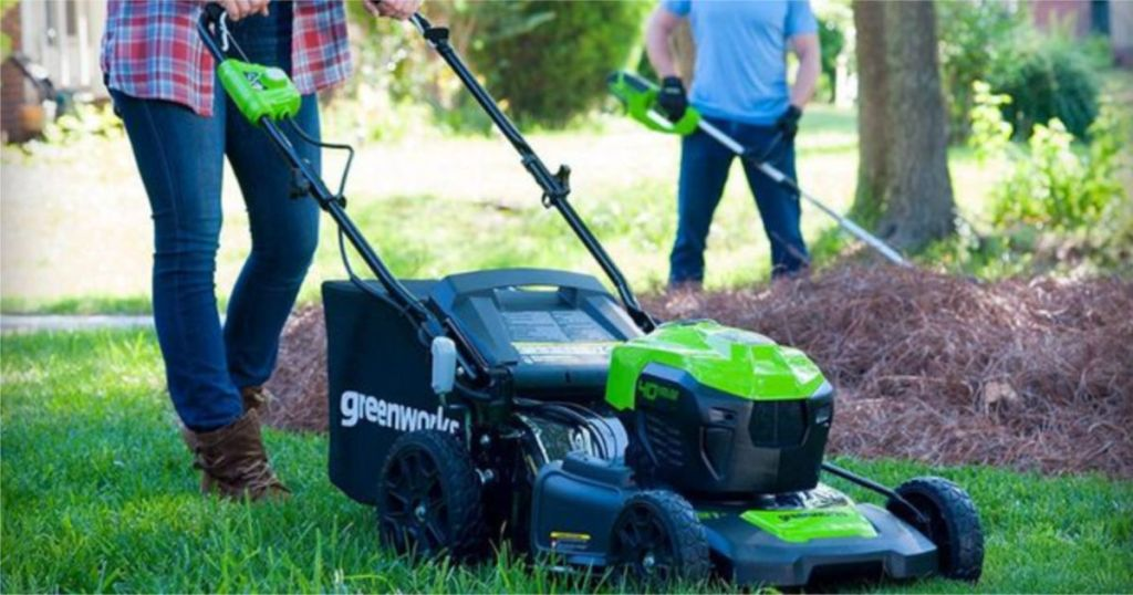 woman mowing grass with Greenworks Brushless Cordless Mower