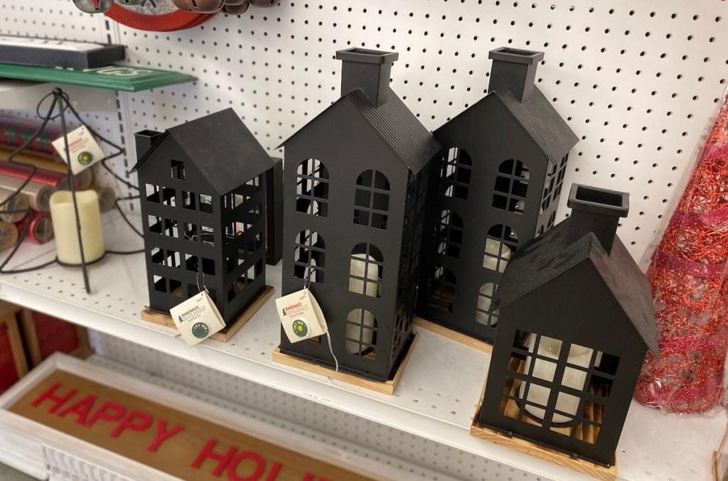 Handmade Holiday Metal Houses on shelves at Joann