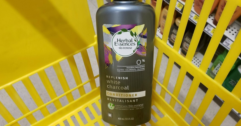 Herbal Essences White Charcoal conditioner bottle in a yellow shopping basket