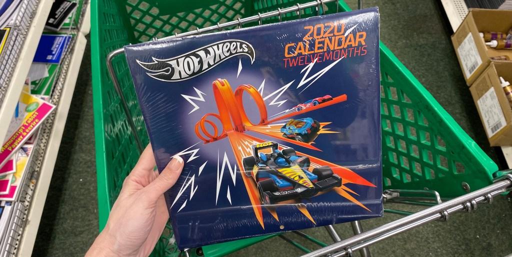 hand holding a Hot Wheels Calendar in a cart