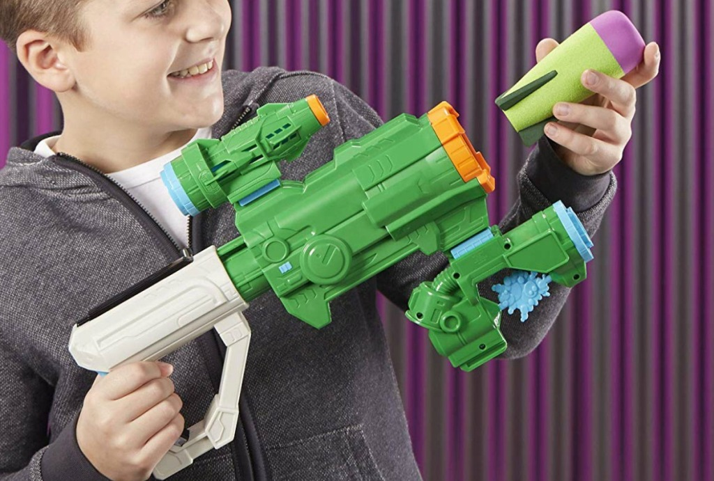 Boy playing with a hulk themed Nerf weapon