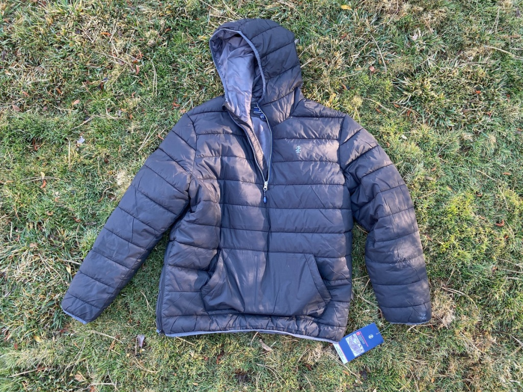izod puffer jacket layed out in grass