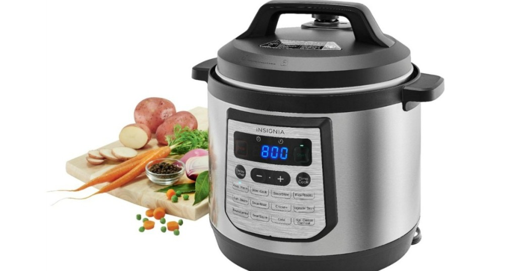 Insignia 6 quart pressure cooker with vegetables next to it