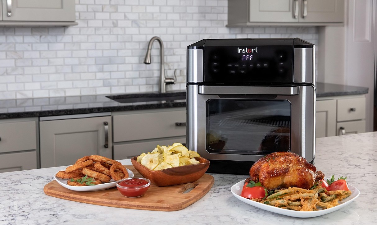 Instant Vortex air fryer with food by it