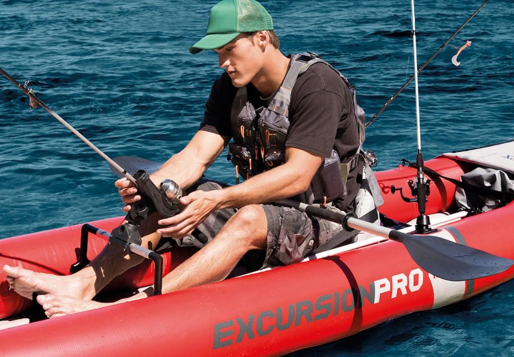 man riding in a Intex Excursion Pro kayak