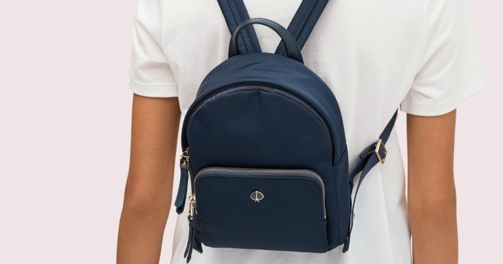 woman wearing a Kate Spade Backpack