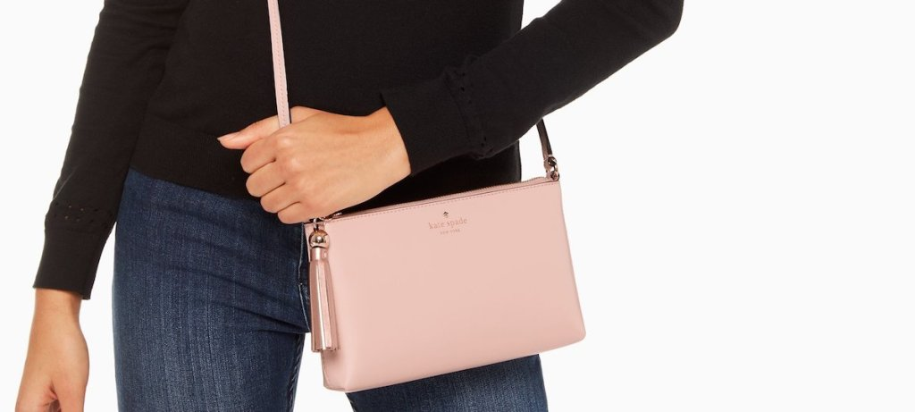 woman holding a Kate Spade Ivy bag