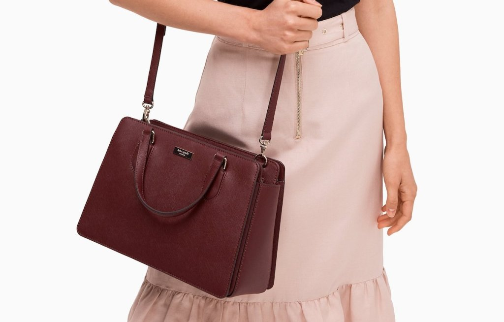 woman carrying a Kate Spade Laurel Way Reese