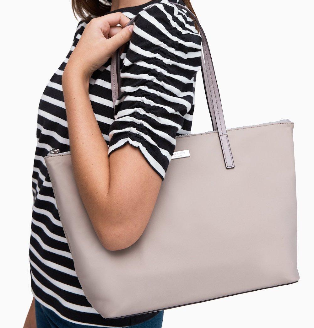 woman carrying a Kate Spade May Street Lida bag