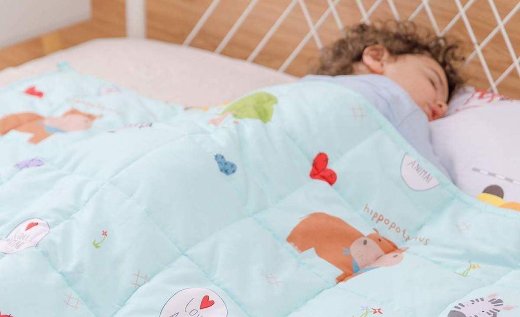 boy sleeping with a blanket