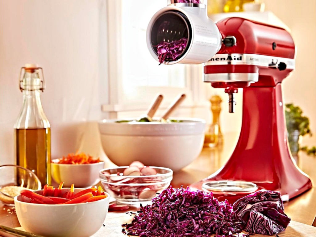 KitchenAid Artisan 5-Quart Tilt-Head Stand Mixer Value Bundle on counter chopping cabbage