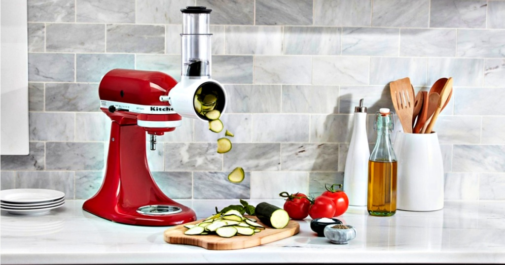 KitchenAid Artisan 5-Quart Tilt-Head Stand Mixer Value Bundle on counter slicing cucumbers