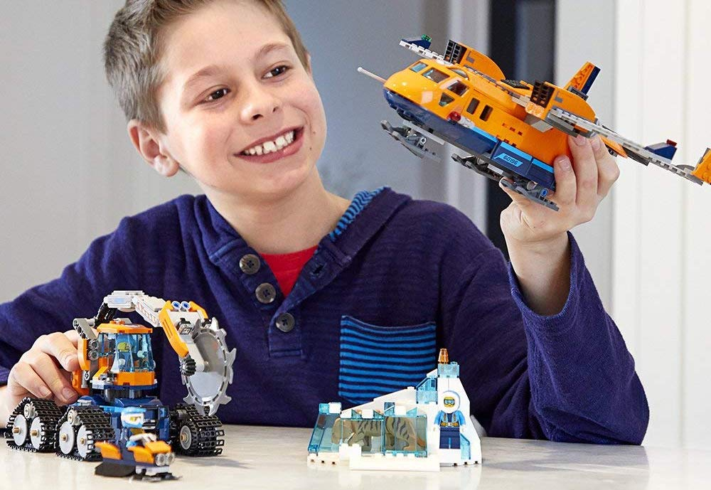 boy playing with LEGO City Arctic Expedition Arctic Supply Plane set