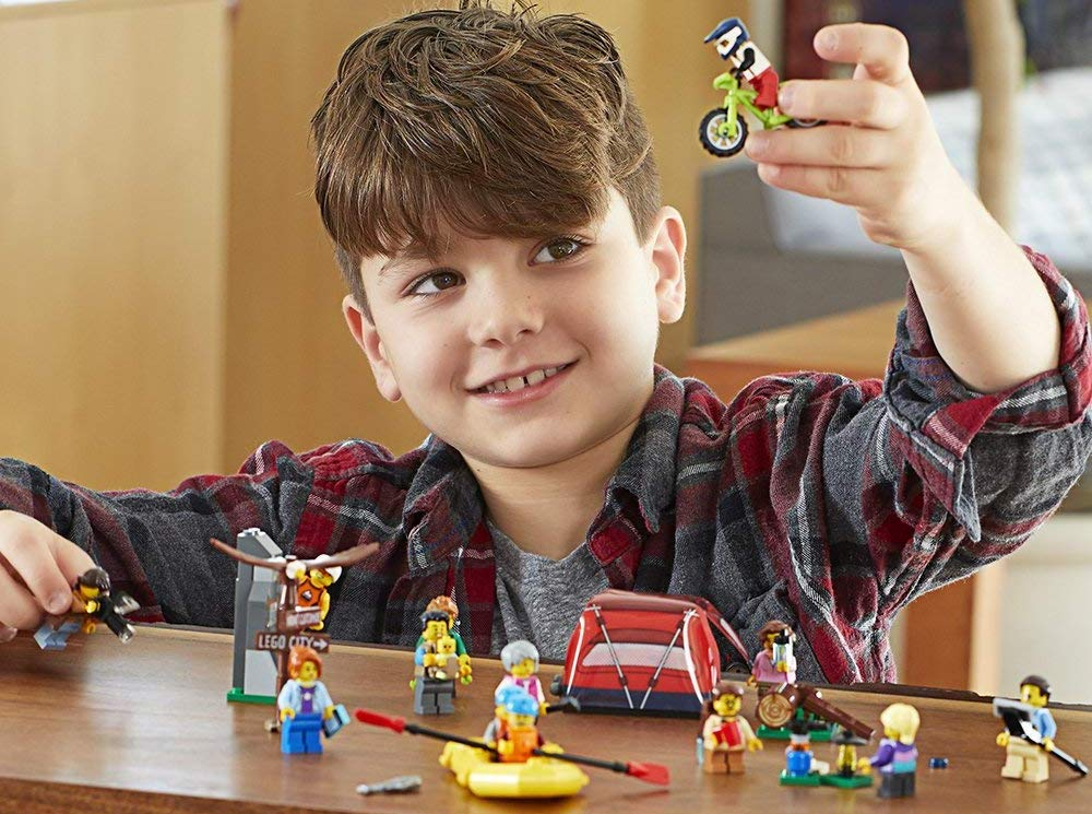 boy playing with LEGO City People Pack – Outdoors Adventures set