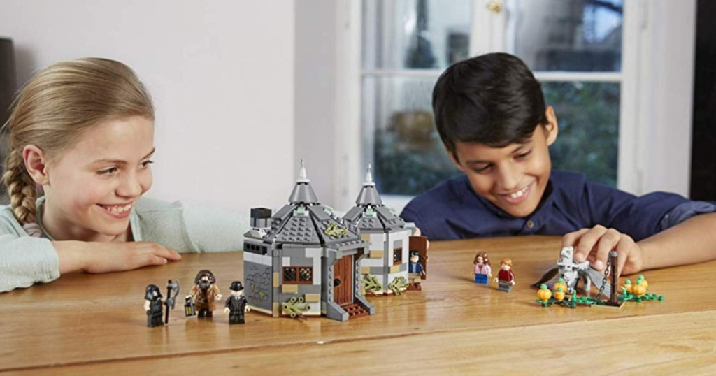 kids playing with LEGO Harry Potter Hagrid's Hut: Buckbeak's Rescue 75947 Building Set on table