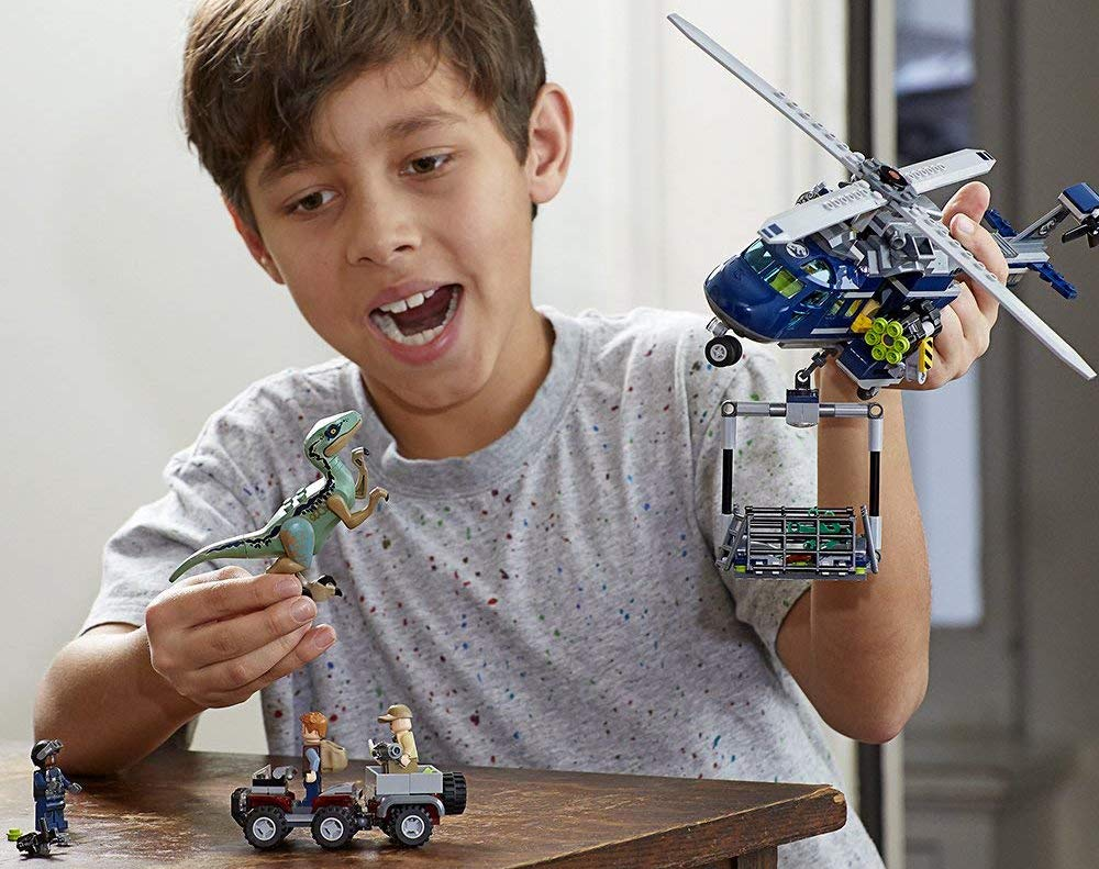 boy playing with LEGO Jurassic World Blue's Helicopter Pursuit set