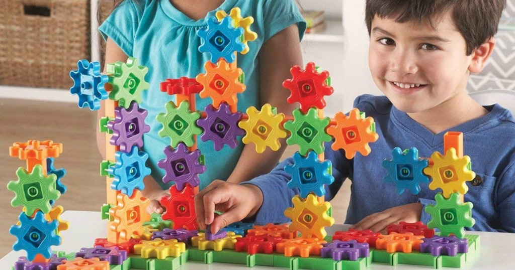kids playing with a Learning Resources Gears Set (1)