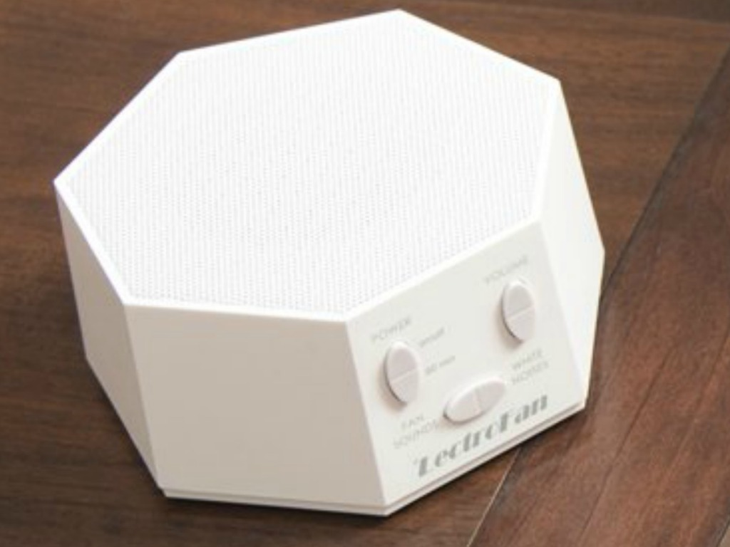 LectroFan brand white noise machine on end table