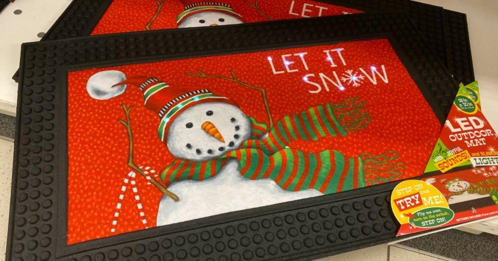 Snowman themed door mat on display at Kohl's