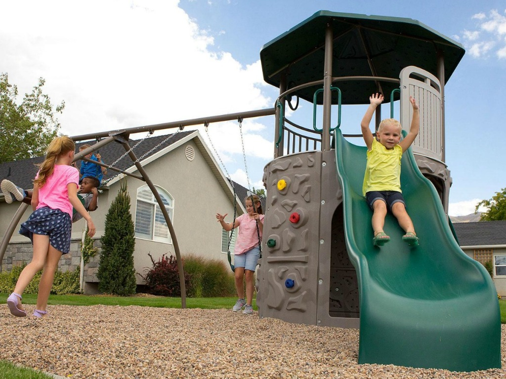 Kids playing on a backyard playset from Sam's Club