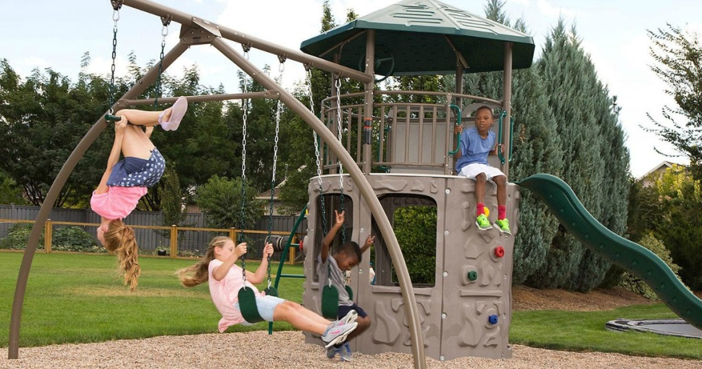 Kids playing on a Lifetime Adventure Tower Playset