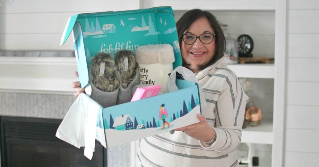 Woman holding FabFitFun Winter Box