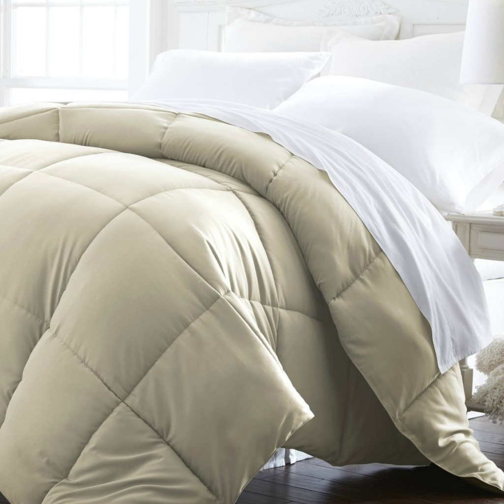 Linens & Hutch brand comforter in beige on bedspread