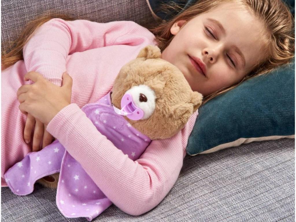 little girl holding little live cubbles