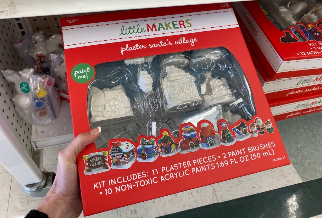 hand holding a Little Makers Plaster Santa's Village set