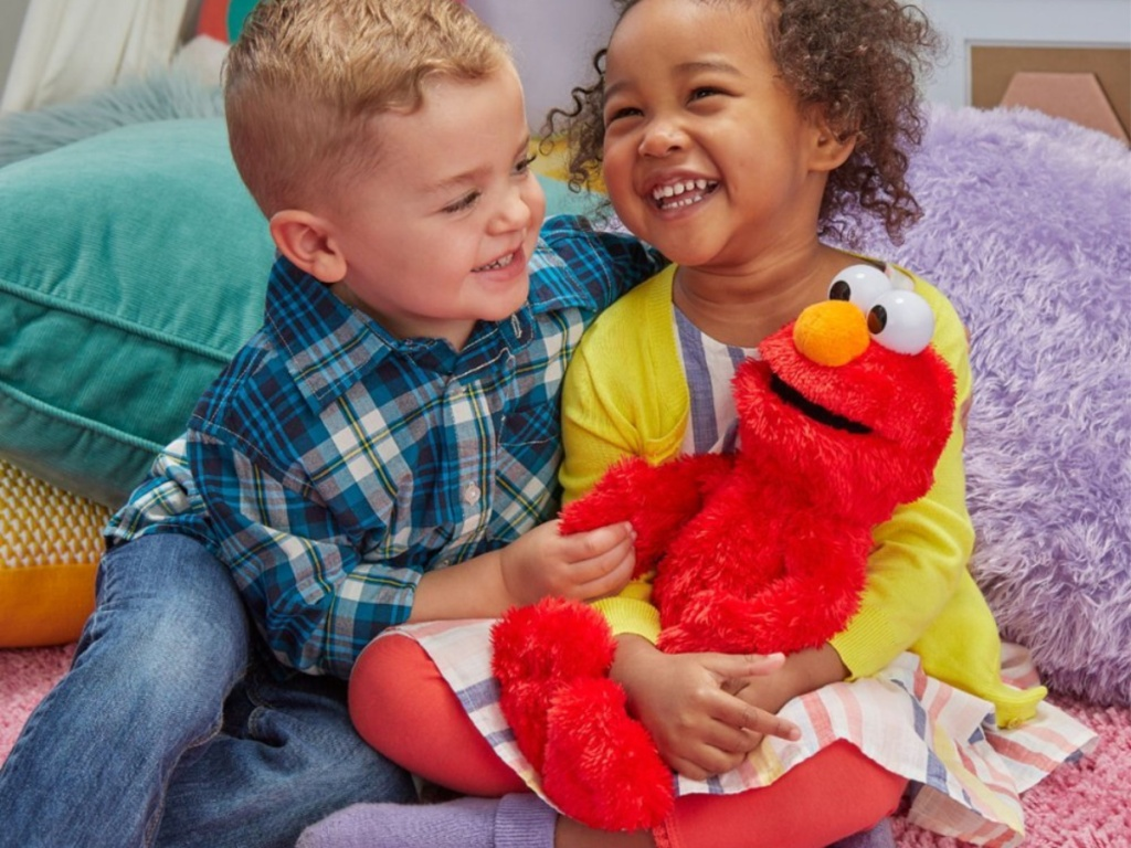 kids playing with elmo