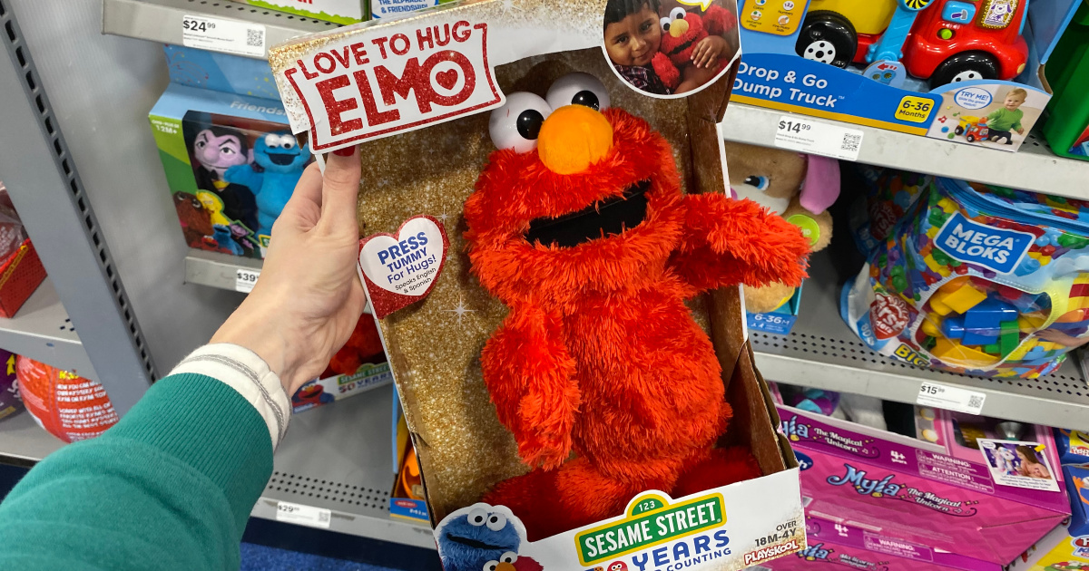 hand holding love to hug elmo in store