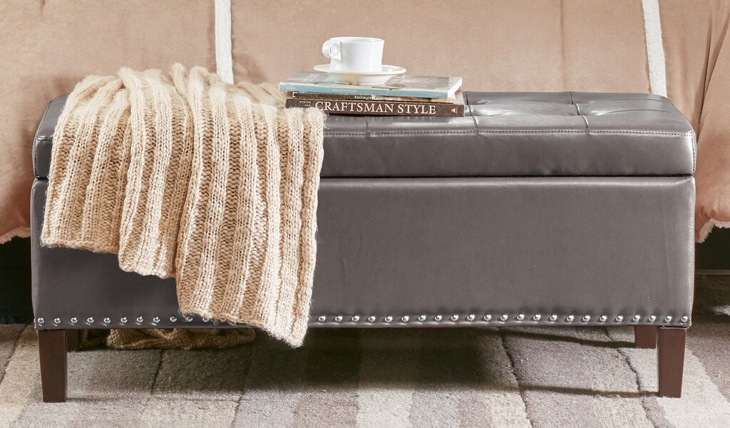 Madison Park Ottoman with blanket and books