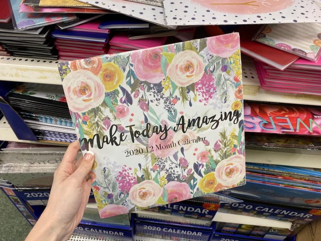 hand holding a Make Today Amazing Calendar