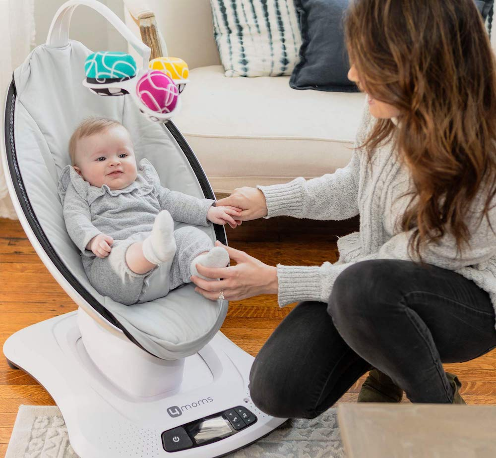 woman next to baby in Mamaroo swing
