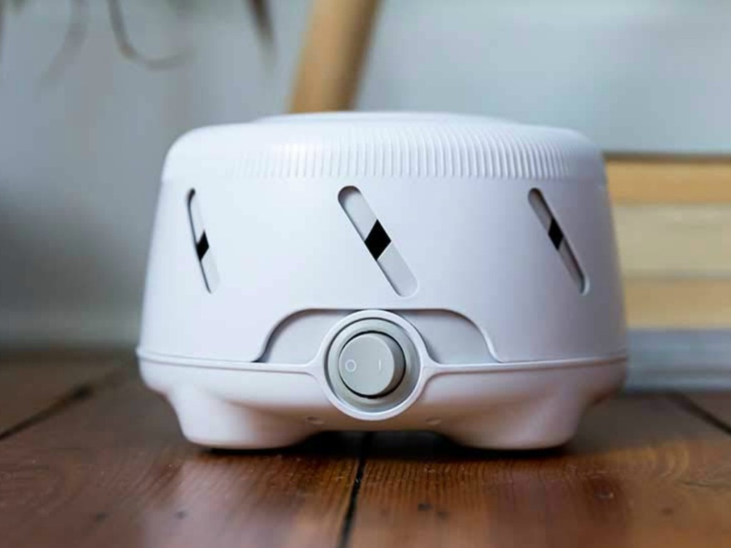 Marpac brand white noise machine in white on the floor