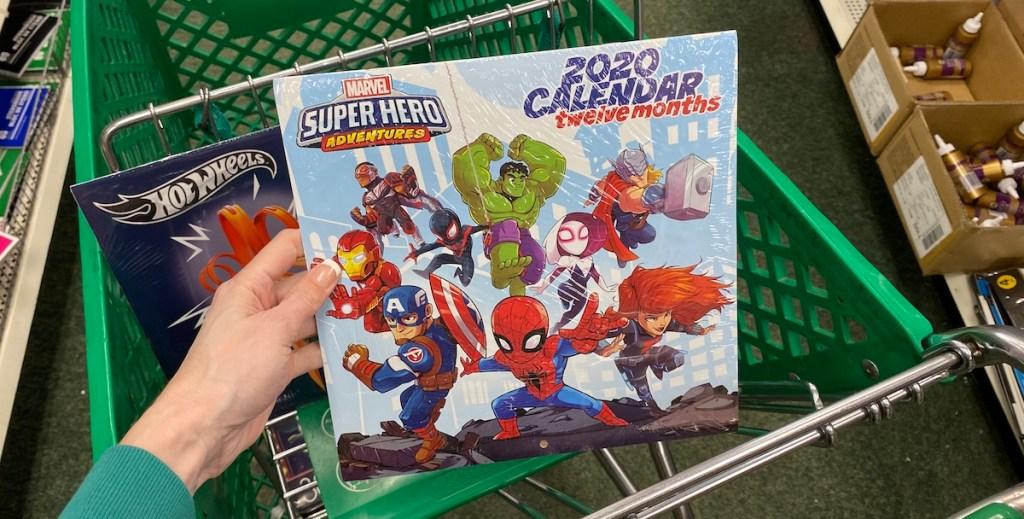 hand holding a Marvel Superheroes Calendar